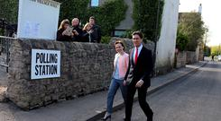 Labour Party leader Ed Miliband and his wife Justine arrive to cast their votes at Sutton village hall in Doncaster Photo credit: Chris Radburn/PA Wire