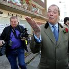 Nigel Farage, leader of the United Kingdom Independence Party (UKIP), leaves after voting at his polling station in Ramsgate REUTERS/Suzanne Plunkett