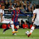 Barcelona's Lionel Messi in action against Bayern Munich's Mehdi Benatia and Jerome Boateng