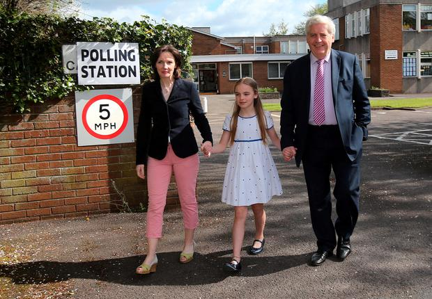 SDLP leader Alasdair McDonnell with his wife Olivia and daughter Aileen outside a polling station at St Bride's Primary School in Belfast as polls open across the UK in the most uncertain General Election for decades Photo credit: Niall Carson/PA Wire
