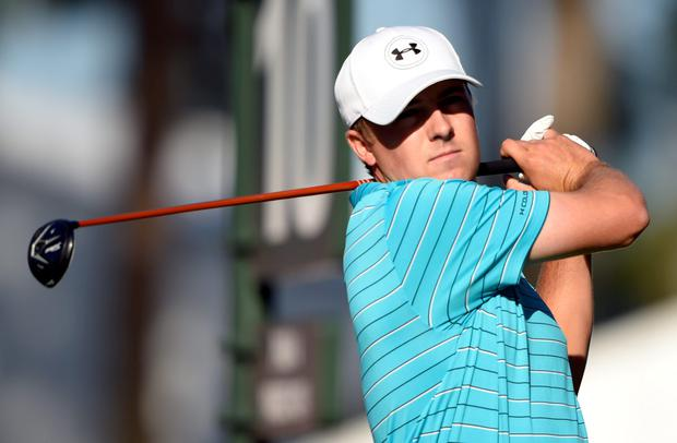 Jordan Spieth hits his tee shot on the 10th hole during the first round of The Players Championship golf tournament at TPC Sawgrass - Stadium Course. Mandatory Credit: John David Mercer-USA TODAY Sports