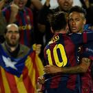 Barcelona's Brazilian forward Neymar da Silva Santos Junior (R) and Barcelona's Argentinian forward Lionel Messi (L) celebrate after scoring a goal during the UEFA Champions League football match FC Barcelona vs FC Bayern Muenchen at the Camp Nou stadium in Barcelona on May 6 (Getty Images)