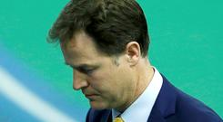 Britain's Liberal Democrat leader Nick Clegg walks off the stage after winning his seat in Sheffield, May 8, 2015. REUTERS/Andrew Yates