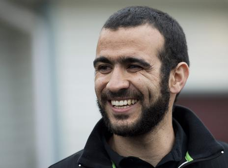 Omar Khadr smiles as he speaks to the media outside his lawyer Dennis Edney's home in Edmonton, Alberta, Thursday, May 7, 2015. (Nathan Denette/The Canadian Press via AP)