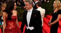 Amal Clooney and George Clooney arrive at the Costume Institute Gala Benefit at The Metropolitan Museum of Art
