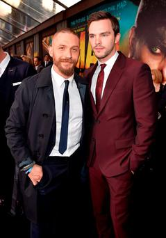Actors Tom Hardy (L) and Nicholas Hoult attend the premiere of Warner Bros. Pictures'