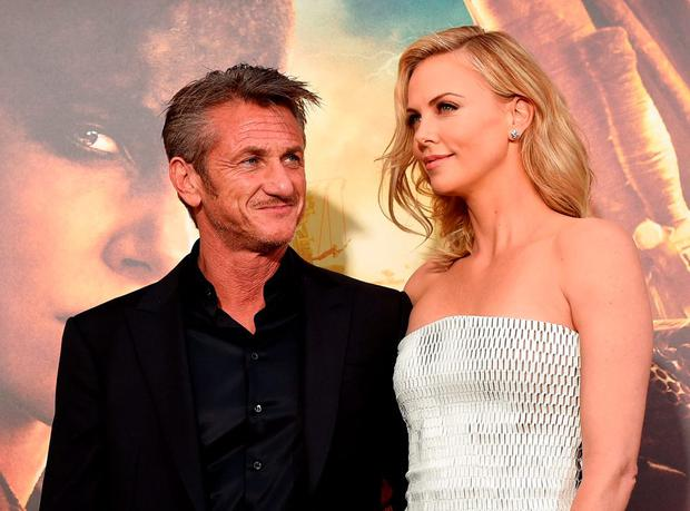 Actors Sean Penn (L) and Charlize Theron attend the premiere of Warner Bros. Pictures'