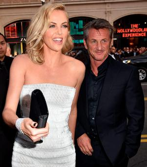 HOLLYWOOD, CA - MAY 07: Actress Charlize Theron (L) and actor Sean Penn attend the premiere of Warner Bros. Pictures'