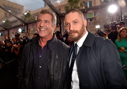 HOLLYWOOD, CA - MAY 07: Actors Mel Gibson (L) and Tom Hardy attend the premiere of Warner Bros. Pictures'