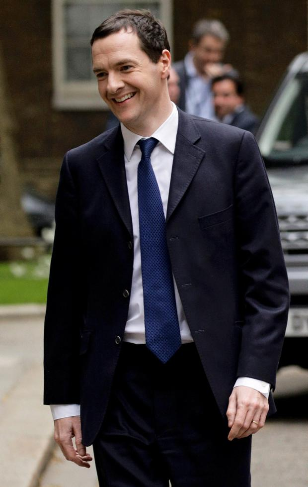 Britain's Chancellor of the Exchequer George Osborne smiles as he returns to number 11 Downing Street in London, Britain May 8, 2015. Prime Minister David Cameron won an emphatic election victory in Britain, overturning predictions that the vote would be the closest in decades to sweep into office for another five years, with his Labour opponents in tatters. REUTERS/Kevin Coombs