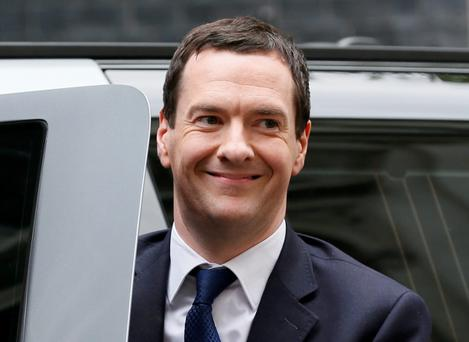 Britain's Chancellor of the Exchequer George Osborne smiles as he arrived back at Number 11 Downing Street after Britain's general election. REUTERS/Stefan Wermuth