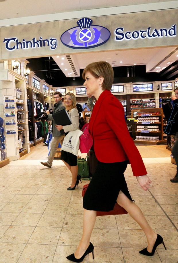 Nicola Sturgeon, leader of the Scottish National Party, walks through Edinburgh Airport in Edinburgh, Scotland, Britain May 8, 2015. Prime Minister David Cameron won an emphatic election victory in Britain, overturning predictions that the vote would be the closest in decades to sweep into office for another five years, with his Labour opponents in tatters. REUTERS/Russell Cheyne