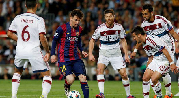 Barcelona's Lionel Messi in action with Bayern Munich's Thiago, Xabi Alonso, Juan Bernat and Mehdi Benatia