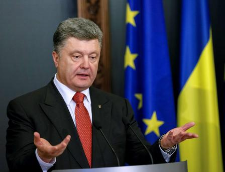 Ukrainian President Petro Poroshenko speaks during a news conference after a meeting with EU top official in Kiev. Reuters/Gleb Garanich