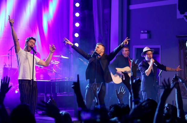Take That (L-R) Howard Donald, Gary Barlow and Mark Owen perform during a secret gig for Magic FM at One Marylebone on April 24, 2015 in London, England.