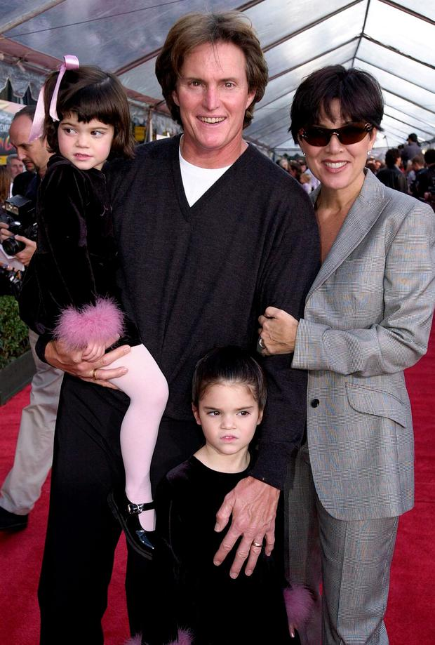 Former US gold medal decathlete Bruce Jenner (C), his wife Kris (R) and children Kylie (L) and Kendall (BELOW) appear at the, 10 December 2000