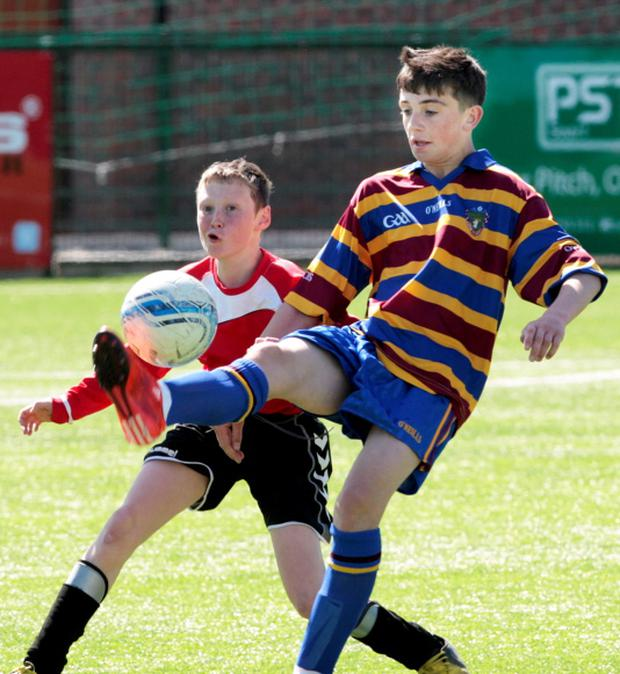 Troy Parrott of O'Connell's controls the ball as Danile Bardler, Killians looks on