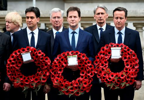 Outgoing opposition Labour Party leader Ed Miliband, British Prime Minister David Cameron and outgoing Liberal Democratic Party leader Nick Clegg attend a VE Day service of remembrance at the Cenotaph in London
