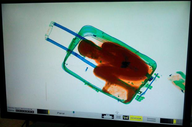 A picture provided by Spanish Guardia Civil shows an X-ray image showing an 8-year-old boy hidden in a suitcase