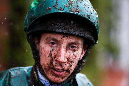 A muddy James Sullivan returns to the weigh-room after battling the elements at Chester yesterday