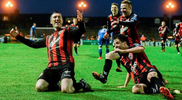 Jason Byrne, Bohemians, celebrates after scoring his side's second goal with team-mates Adam Evans and Lorcan Fitzgerald. SSE Airtricity League Premier Division, Bohemians v Limerick FC, Dalymount Park, Dublin Picture credit: David Maher / SPORTSFILE