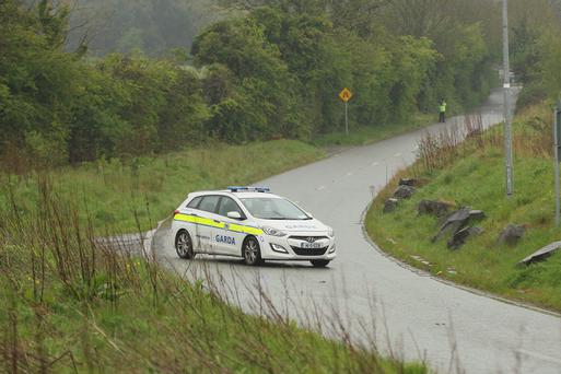 Gardaí close the road in Steelstown, Co Kildare, where the baby was found.