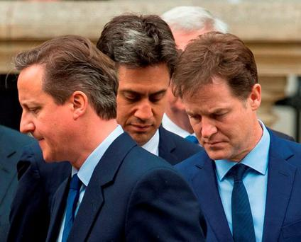 David Cameron, Ed Miliband, and Nick Clegg during a Service of Remembrance to mark the 70th anniversary of VE Day, at the Cenotaph, in Whitehall, London. Photo: PA