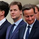 WINNER TAKES ALL: Outgoing Labour leader Ed Miliband, outgoing Liberal Democrat leader Nick Clegg and re-elected British Prime Minister David Cameron attend a ceremony at the Cenotaph in London to mark VE Day just hours after the Conservative Party defied all the polls and won an overall majority in the UK elections