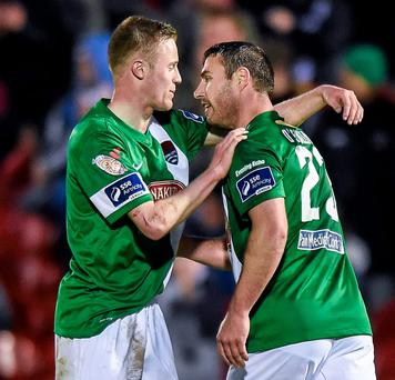 Mark O'Sullivan (R) is congratulated by team-mate Kevin O'Connor after scoring Cork City's winning goal