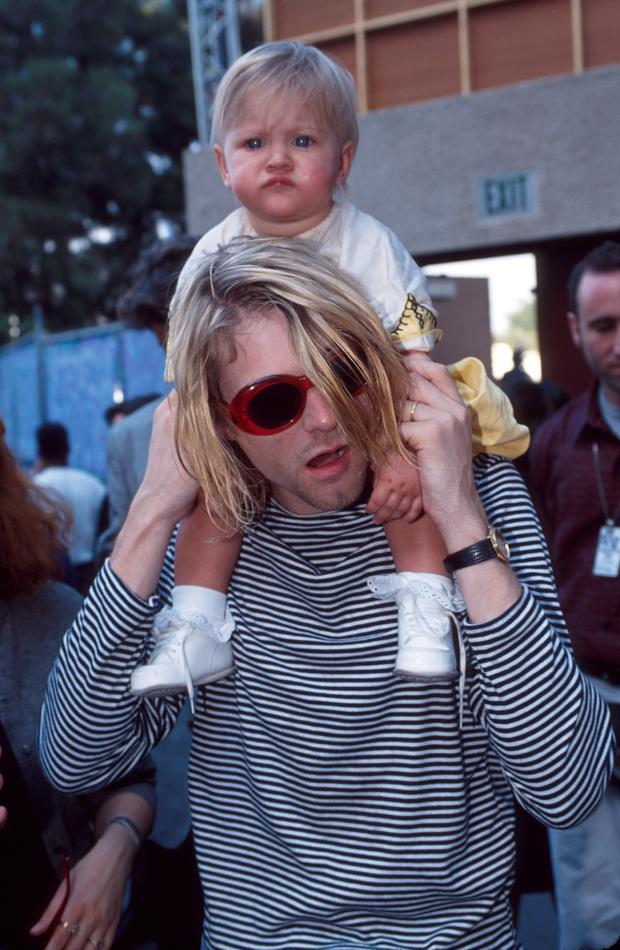 Kurt Cobain of Nirvana and daughter Frances Bean Cobain at the Universal Ampitheater in Universal City, California (Photo by Kevin Mazur/WireImage)