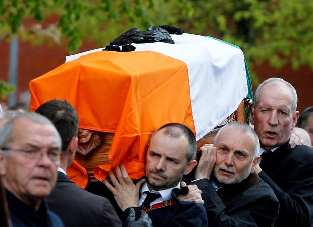 Bobby Storey (right) and Sean 'Spike' Murray (centre) carry the coffin of Gerard