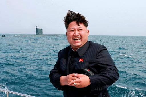 North Korean leader Kim Jong Un watches the test-fire of a strategic submarine underwater ballistic missile (not pictured), in this undated photo released by North Korea's Korean Central News Agency (KCNA) in Pyongyang. Photo: Reuters