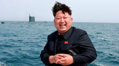North Korean leader Kim Jong Un watches the 'test-fire' of a strategic submarine underwater ballistic missile Credit: KCNA