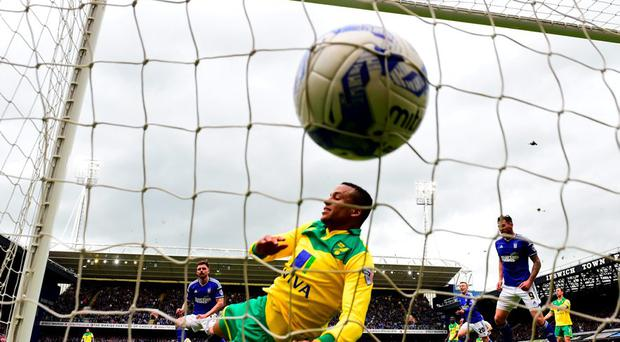 Ipswich Town's Paul Anderson scores past defender Martin Olsson of Norwich during the Sky Bet Championship Playoff semi-final first leg at Portman Road