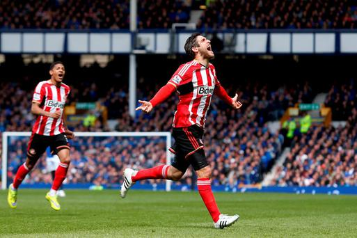 Danny Graham celebrates scoring against Everton at Goodison Park.
