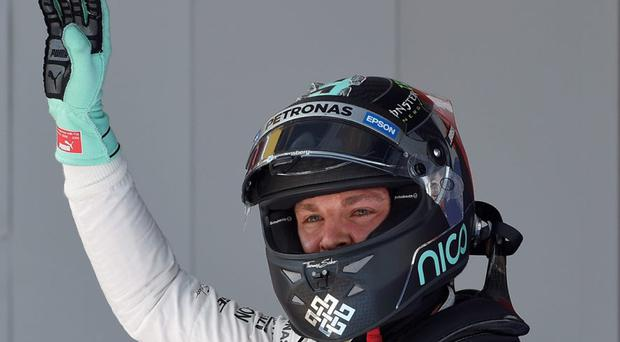 Nico Rosberg celebrates in the parc ferme after the qualifying session at the Circuit de Catalunya