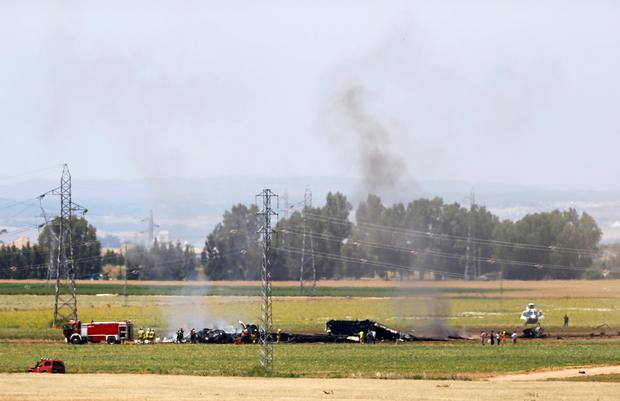 The remains of Airbus A400M are seen after crashing in a field near Seville Credit: Marcelo del Pozo