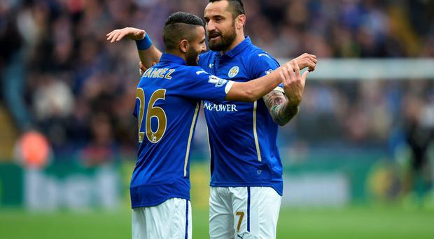 Riyad Mahrez celebrates scoring the second goal with Marcin Wasilewski of Leicester City at The King Power Stadium
