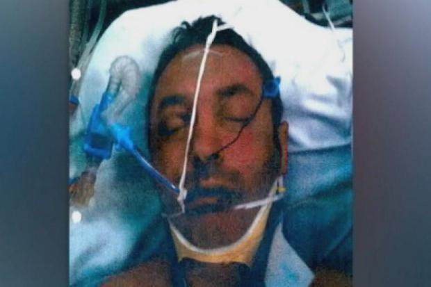 A photo shown in court of Irish tourist Timothy McCarthy in hospital