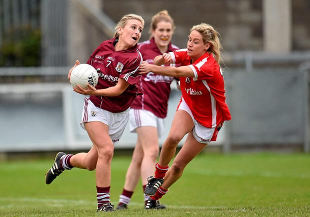 Sinead Burke of Galway, in action against Cork's Orla Finn during the TESCO HomeGrown Ladies National Football Division 1 Final