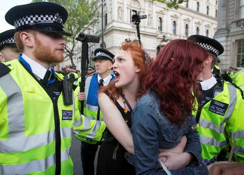 People pictured during an anti-austerity protest in central London. Photo credit should read: Rick Findler/PA Wire