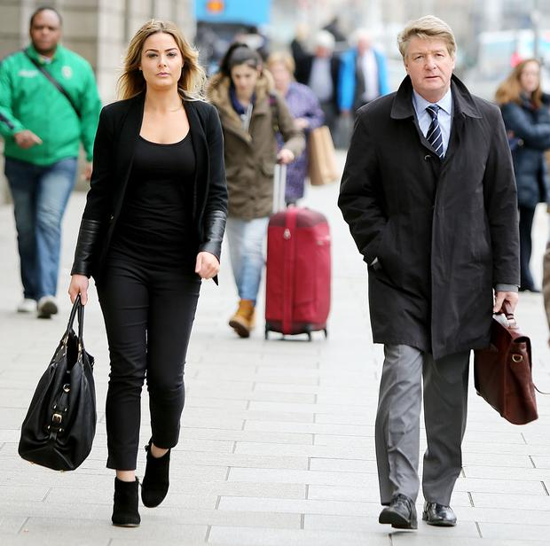 BATTLE READY: Brian O'Donnell, right, on his way into court in March with his daughter Blaise