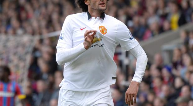 Manchester United's Marouane Fellaini celebrates scoring an unlikely winner against Crystal Palace