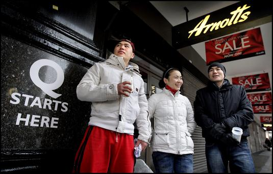 Queueing outside Arnotts on Henry Street on Christmas Day yesterday in advance of the St Stephens Day Sales was from left, Nara Enkhbaatar, Zula Turmunkh and Sanna Lhansuren all from Mongolia and now living in Dublin City Centre. Pic Steve Humphreys 25th December 2009.