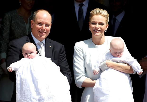 Prince Albert II of Monaco and his wife Princess Charlene hold their twins Prince Jacques and Princess Gabriella as they leave Monaco's Cathedral after their christening ceremony