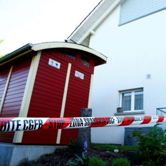 A police ribbon is seen in front of a house in Wuerenlingen, Switzerland