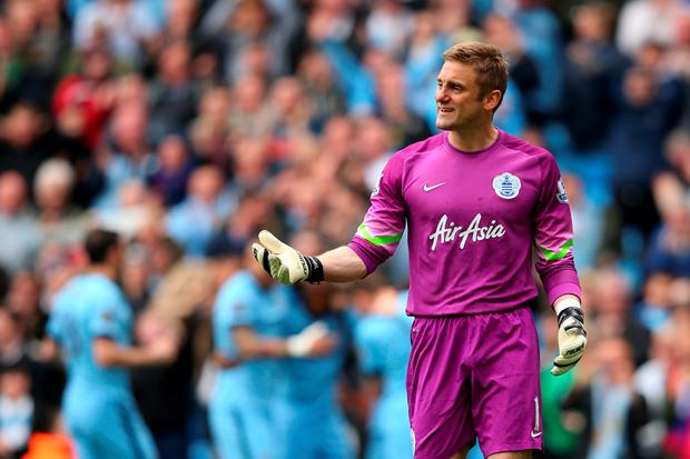 MANCHESTER, ENGLAND - MAY 10: Dejected goalkeeper Robert Green of QPR reacts after conceding the opeing goal to Sergio Aguero of Manchester City during the Barclays Premier League match between Manchester City and Queens Park Rangers at the Etihad Stadium on May 10, 2015 in Manchester, England. (Photo by Alex Livesey/Getty Images)