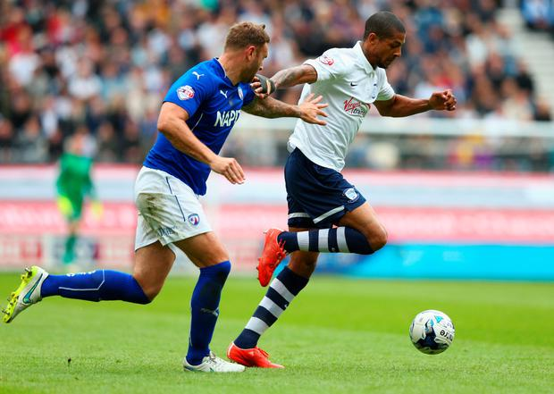 PRESTON, ENGLAND - MAY 10: Jermaine Beckford of Preston North End holds off Ian Evatt of Chesterfield during the Sky Bet League One Playoff Semi-Final second leg match between Preston North End and Chesterfield at Deepdale on May 10, 2015 in Preston, England. (Photo by Matthew Lewis/Getty Images)