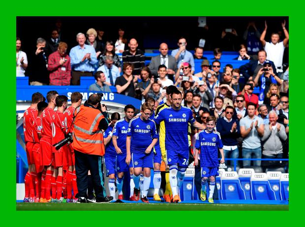 LONDON, ENGLAND - MAY 10: Captain John Terry of Chelsea leads out his team through a guard of honour by the Liverpool players during the Barclays Premier League match between Chelsea and Liverpool at Stamford Bridge on May 10, 2015 in London, England. (Photo by Shaun Botterill/Getty Images) ***BESTPIX***
