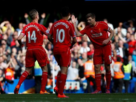 Liverpool's English midfielder Steven Gerrard (R) celebrates scoring the equalising 1-1 goal during the English Premier League football match between Chelsea and Liverpool at Stamford Bridge in London on May 10, 2015. AFP PHOTO / IAN KINGTON RESTRICTED TO EDITORIAL USE. No use with unauthorized audio, video, data, fixture lists, club/league logos or live services. Online in-match use limited to 45 images, no video emulation. No use in betting, games or single club/league/player publications.IAN KINGTON/AFP/Getty Images